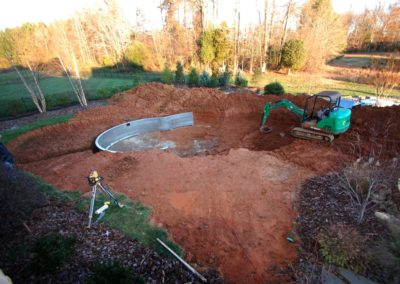5. Pool walls are set in place as the excavation continues.